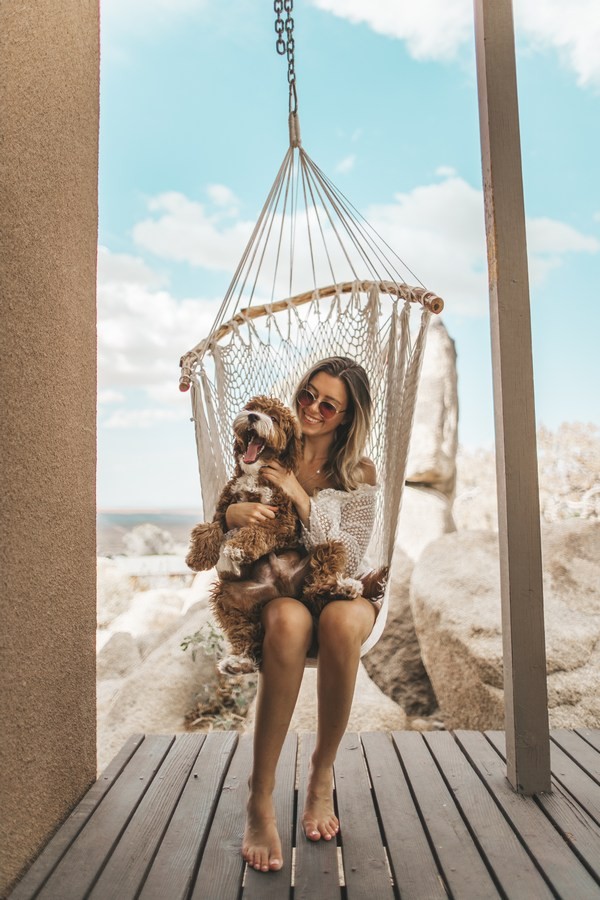 a hanging chair with a relaxing woman
